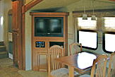 Dining area of the Dogwood Acres fifth wheel rental trailer.