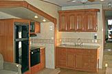 Kitchen area of the Dogwood Acres fifth wheel rental trailer.
