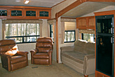 Slide-out living area of the Dogwood Acres fifth wheel rental trailer.