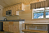 Kitchen and dining area of the Dogwood Acres full-service camping cabin.