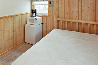 Deluxe Cabin Queen Bed at Dogwood Acres Campground